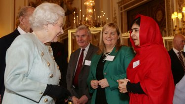 Britain's Queen Elizabeth II meets Malala Yousafzai during a reception for youth, education and the Commonwealth at Buckingham Palace, London, in October, 2013.