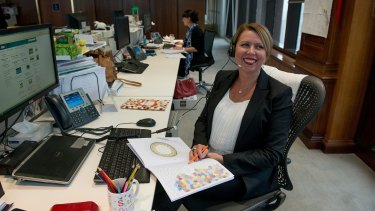 ANZ employee Kerrie Harris with her adult colouring book.