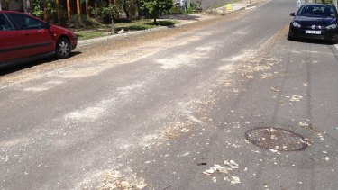 Residents fear asbestos blown into their street by the storm will become airborne.