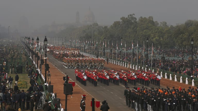 Soldiers march down Rajpath, a ceremonial boulevard that runs from Indian President's palace to war memorial India Gate, during a full dress rehearsal ahead of Republic Day parade in New Delhi, India.