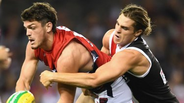 Angus Brayshaw was taken from the field after receiving a nasty bump.
