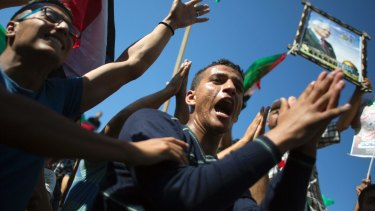 Palestinians in Gaza celebrate the signing of a reconciliation agreement between Hamas and Fatah on October 12.