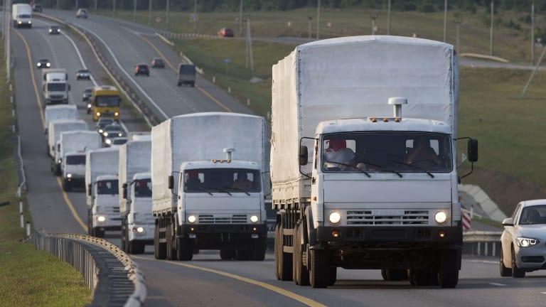 A convoy of Russian trucks that allegedly carried humanitarian aid passing along the Don highway towards Ukraine in August 2014.