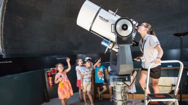 Sydney Observatory tour guide Kirsten Banks says the school holiday program usually attracts hundreds of families.