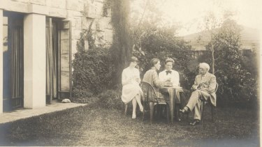 Walter Burley Griffin and Marion Griffin in their garden at Castlecrag with architect Louise Lightfoot and Walter's father George.
