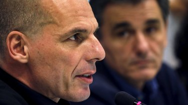 Newly-appointed Finance Minister Euclid Tsakalotos (right) and outgoing Yannis Varoufakis address a news conference during a handover ceremony in Athens, Greece.