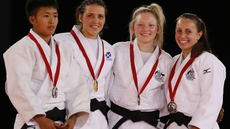 Chloe Rayner (second right) and Amy Meyer (right) from Australia pose with their bronze medals.
