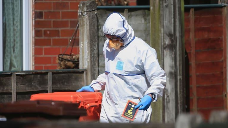 Police forensic investigators search the property of Salmon Abedi in connection with the Manchester attack.
