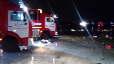 Russian emergency trucks near the scene of the plane crash at the Rostov-on-Don airport.
