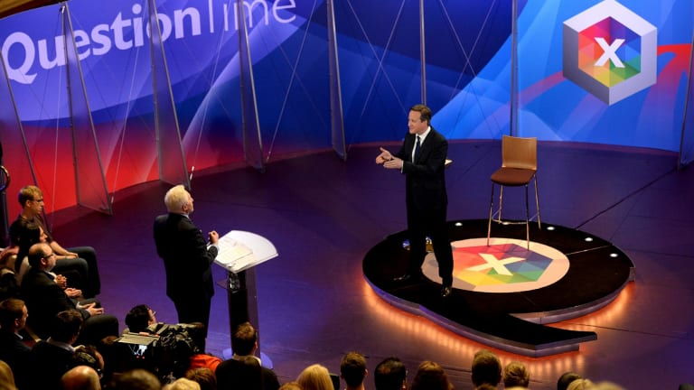 David Cameron takes part in a special BBC Question Time program, hosted by David Dimbleby (standing left) on Thursday, with the three main party leaders appearing separately.