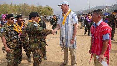 Mr Simpkins greets Karen guerrillas at their Revolution Day event in Myanmar.