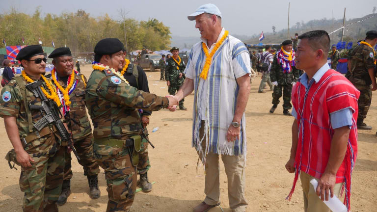 Mr Simpkins greets Karen guerrillas at their Revolution Day event in Myanmar.