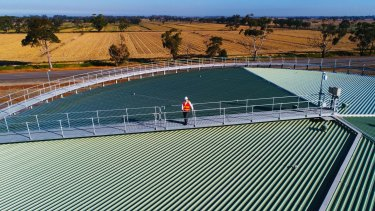 Cameron FitzGerald, general manager of strategy and planning, CityWest Water on top of a 20 megalitre recycled water storage tank.