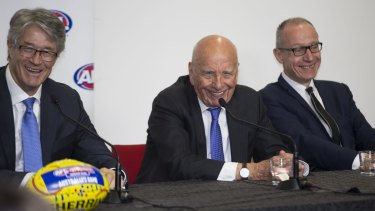 News executives Mike Fitzpatrick, Rupert Murdoch and Robert Thompson announce a 2 billion dollar Foxtel deal at AFL Headquarters in 2015.