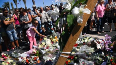 People visit the scene and lay tributes to the victims of a terror attack on the Promenade des Anglais in Nice, France.