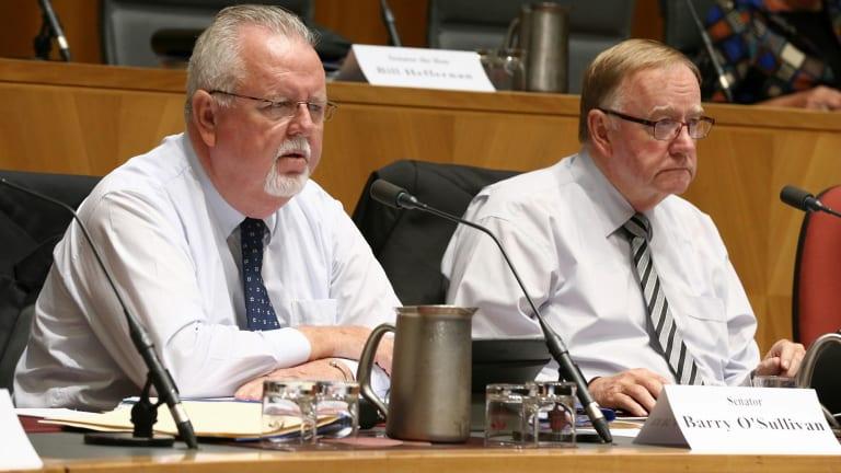 Senators Barry O'Sullivan and Ian Macdonald.
