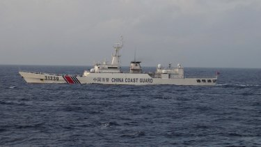 An armed Chinese coast guard ship sails in the water near islands, known as the Senkaku in Japanese and the Diaoyu in Chinese. It was spotted for the first time on Tuesday near islands at the centre of a long-running territorial dispute between the two Asian giants.