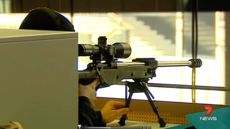 A sniper trains his gun on the Lindt cafe during the siege.