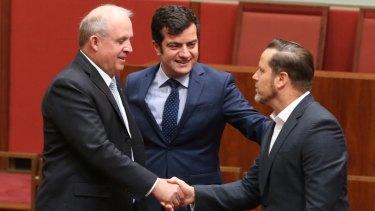 "Greens senator Peter Wish-Wilson, born in Singapore is congratulated by Nationals senator John ""Wacka"" Williams and Iran-born ALP senator Sam Dastyari."