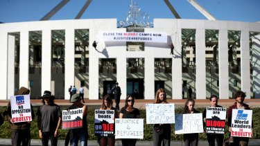 Protestors on the forecourt of Parliament House in Canberra on Thursday.