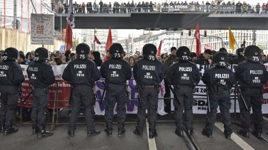 Police secure the streets during a counter demonstration against far-right groups  in Cologne on Sunday.