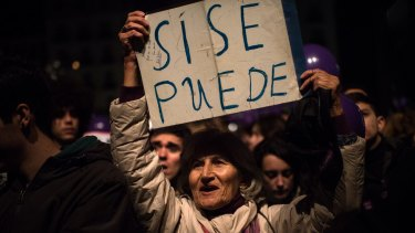 A Podemos (We Can) supporter holds up a banner reading 'Yes, we can' after elections in December. But a coalition government could not be formed and Spaniards will need to return to the polls.