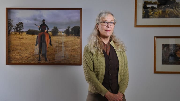 Photo media artist Anne Zahalka at the National Art School with her work Outlawed.