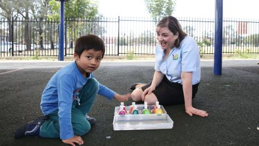 Grace Fava at the Autism Advisory and Support Service in Liverpool with five-year-old client Morfael.