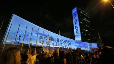 Messages in support of action to combat climate change are projected onto the side of the UN building in New York, ahead of the international summit that begins this month.