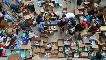 Volunteers sort through items donated for disaster relief in Dallas last week.