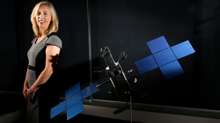 Satellite architect Julia Dickinson with a model of an NBN Co broadband satellite.