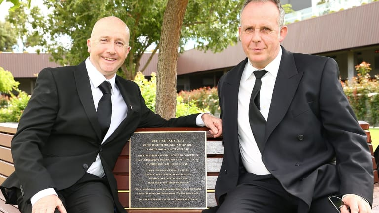 Memories: Track rider Steve Nicholson and foreman Robin Trevor-Jones pose next to the plaque installed as a tribute to Red Cadeaux on Black Caviar Lightning Day at Flemington.