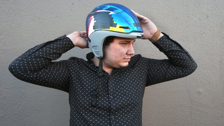Alfred Boyadgis, co-founder of Forcite Helmet Systems, wearing a prototype of their AI ski helmet. The helmet will communicate with its surrounds and the internet to enhance the ski experience for the wearer.