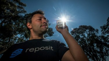 Reposit Power chief executive Dean Spaccavento with the home device used to transmit solar battery power.