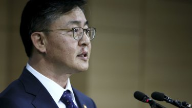 South Korean Unification Minister Hong Yong-pyo announces the suspension of the Kaesong industrial complex operations on Wednesday.