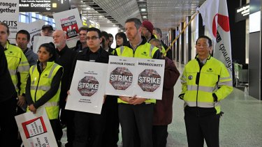 Workers at Melbourne Airport stop work amid an industrial campaign for better pay earlier this year.