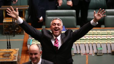 Treasurer Joe Hockey waves to the public gallery ahead of Opposition Leader Bill Shorten delivering the budget in reply address at Parliament House.