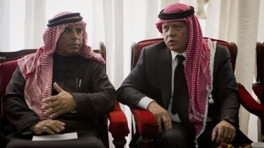 Condolences: Jordanian King Abdullah II (right) talks with Safi al-Kasasbeh, father of slain pilot Muath.