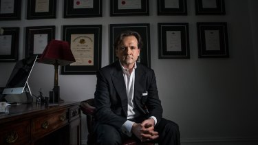 British-trained plastic surgeon Patrick Tansley says he was threatened by Australian plastic surgeons.