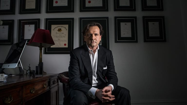 British-trained plastic surgeon Patrick Tansley says he was threatened by Australian plastic surgeons.