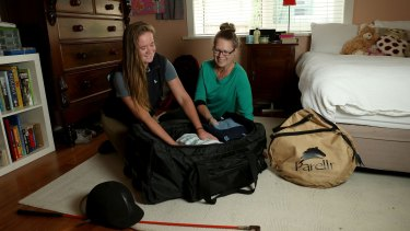 Milly Agar, left, with her mother Michelle, packs for another term at her Hamilton boarding school. She says boarding has been a positive experience.