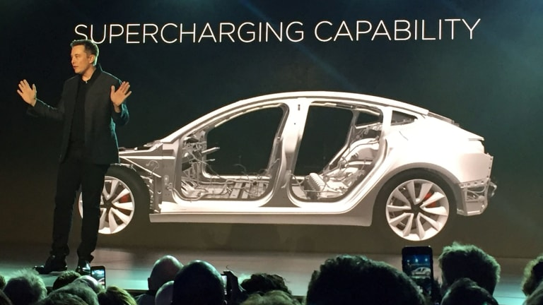Tesla chief executive Elon Musk unveils the Model 3 at the company's design studio in California.