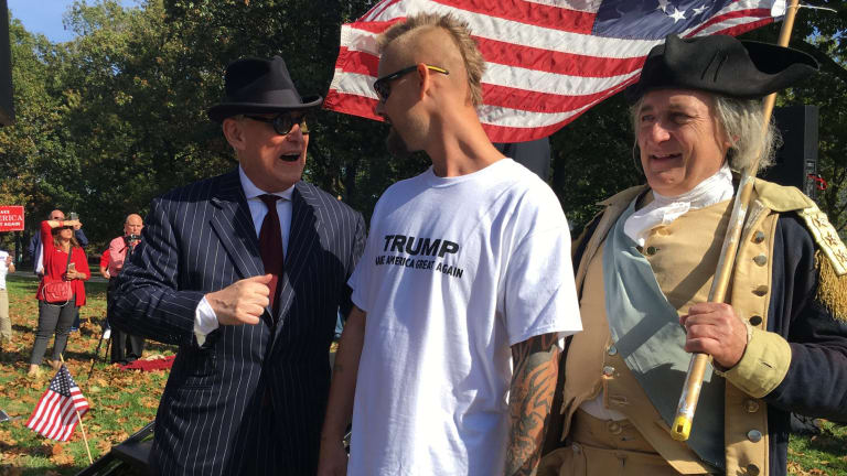 The dapper Roger Stone mixes with Trump supporters, one of them dressed as George Washington.