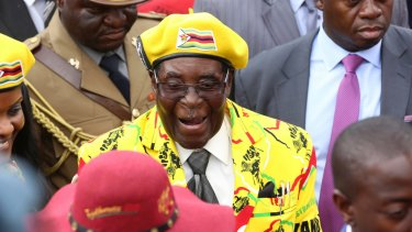 Zimbabwean President Robert Mugabe, centre, arrives for a solidarity rally in Harare last week.