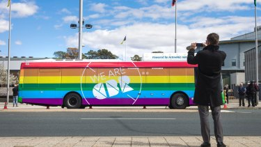 Compare the pair: one of the ACT government's rainbow buses for marriage equality.