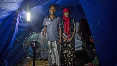 Rohingya refugees Syaifullah, 22 and his wife Yasminara Begum, 18, at a temporary shelter in Bayeun.