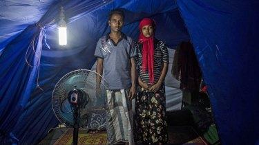 Rohingya refugees Syaifullah, 22 and his wife Yasminara Begum, 18, at a temporary shelter in Bayeun.