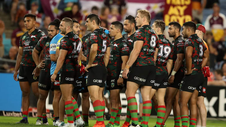 Dejected: Souths players come to terms with a tough defeat.