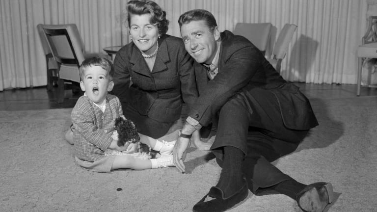 Patricia Kennedy, JFK's sister, Peter Lawford and a two-year-old Christopher.