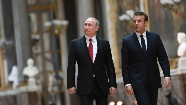 French President Emmanuel Macron and Vladimir Putin in the Galerie des Batailles at Versailles, France, last month.